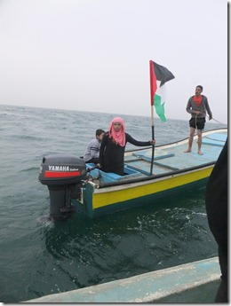 Gaza's woman fisher, Madleen Kolab, protesting at sea